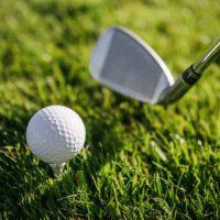 Golf club and ball closeup