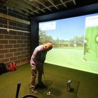 Golf simulator set up in a garage